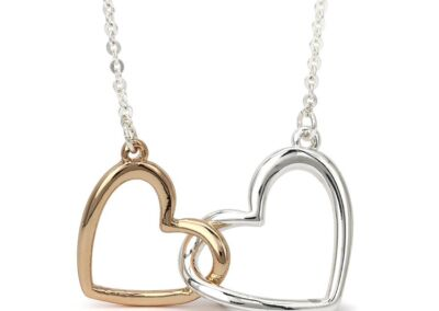 silver plated double heart necklace .