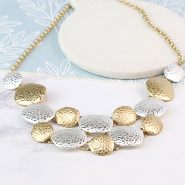 silver and gold plated necklace.