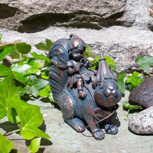 ornament of a fairy riding a squirrel