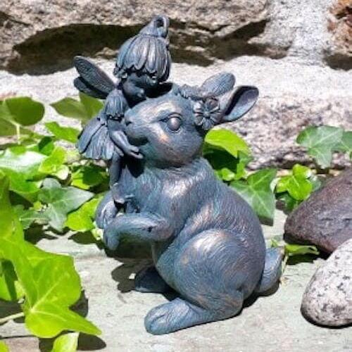 Ornament of a flower fairy cuddling a rabbit