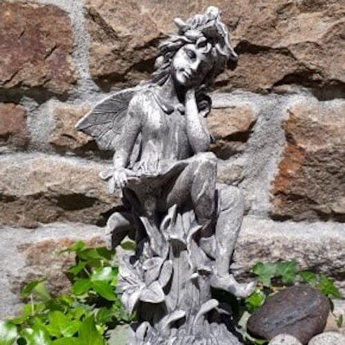 Fairy garden ornament, stone look, sitting , thinking