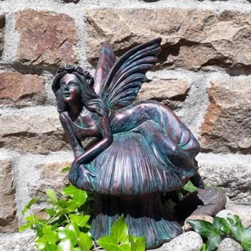 Fairy on a toadstool bronze garden decoration
