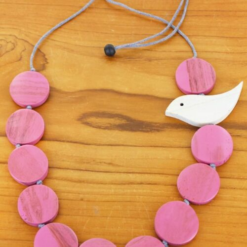 Wooden Necklace With Pink Circles and a White Dove