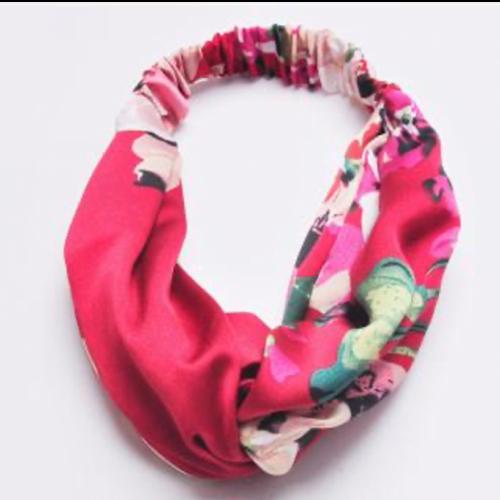 Headband in vibrant berry colours . Faux silk
